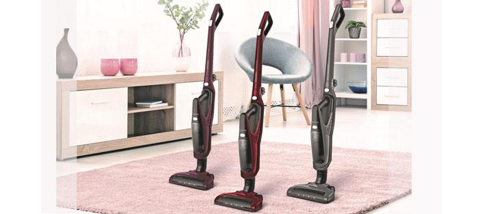 Grundig Akku-und Handstaubsauger Modelle auf Wohnzimmerteppich. Foto: Grundig